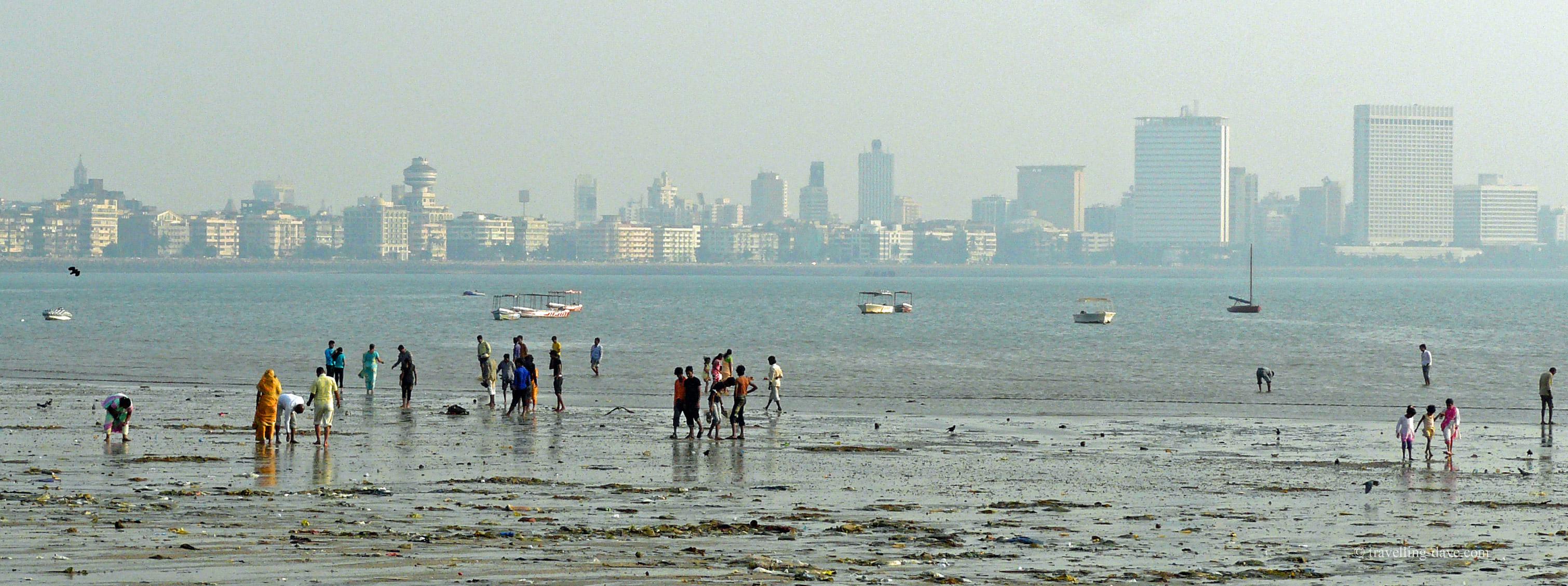 Mumbai skyline and people on the beach