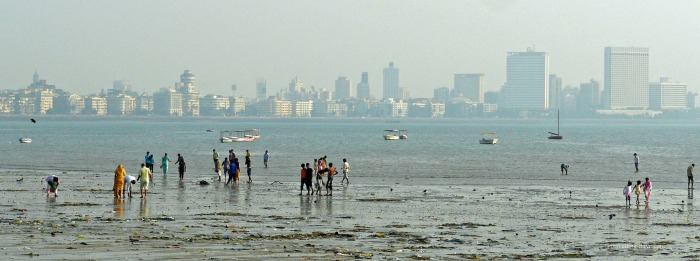 Mumbai skyline and people on the beach
