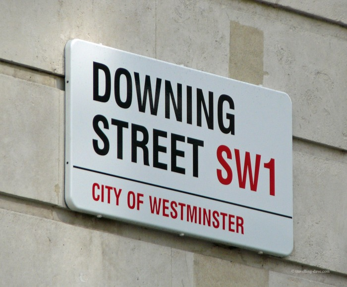 Looking up at Downing Street sign