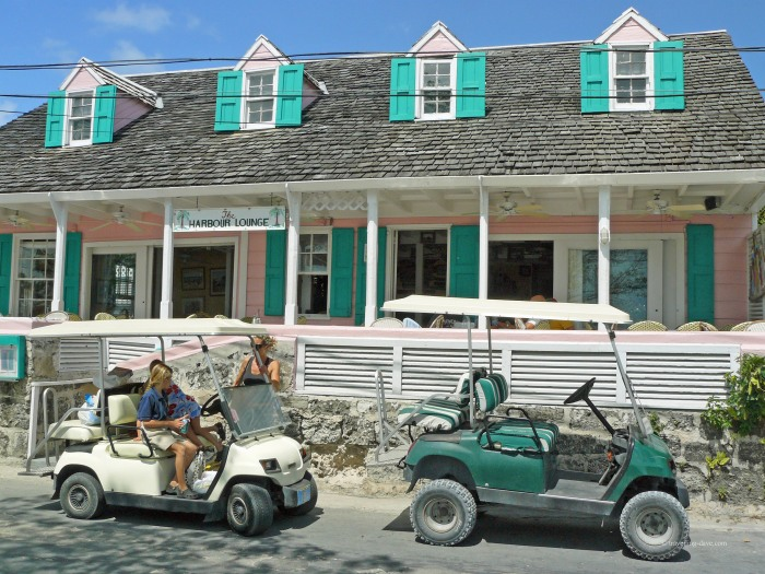 Golf buggies parked outside a restaurant on Harbour Island