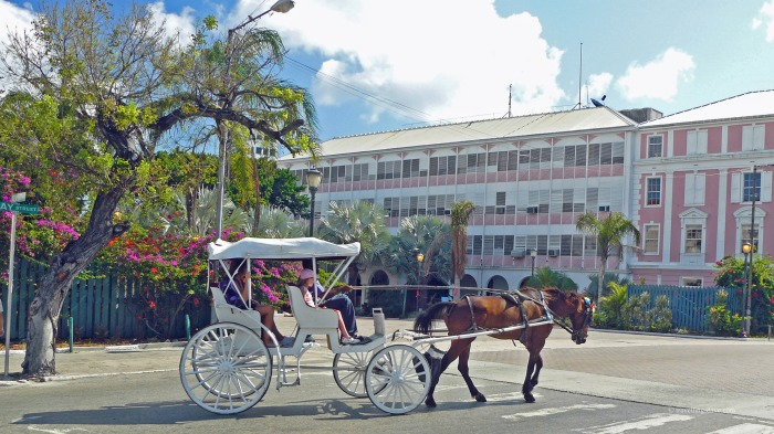 A horse-drawn carriage makes its way through Nassau in the Bahamas
