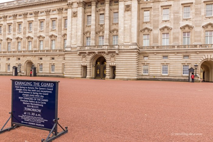 Blue board with Changing of the Guard schedule at Buckingham Palace
