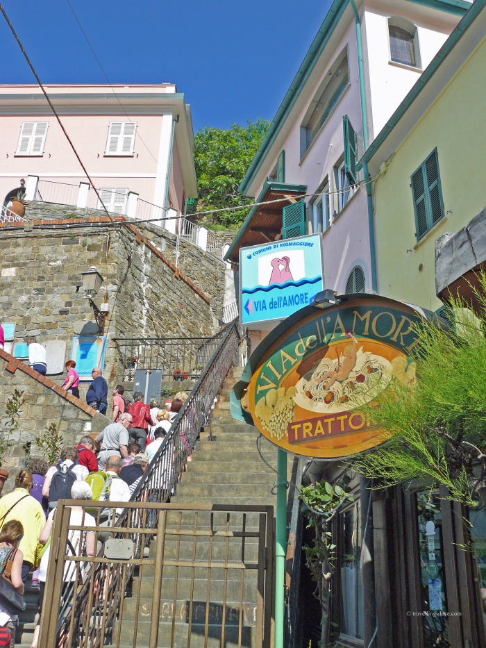 People climbing steps at the start of the Lovers' Walk in Riomaggiore