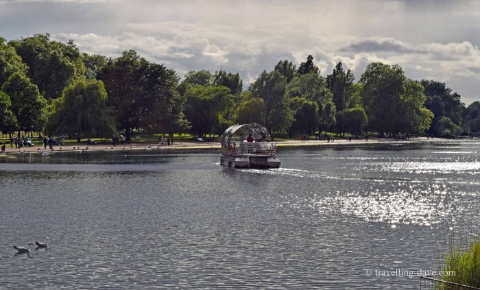 View of a solar powered boat on the Serpentine in London's Hyde Park