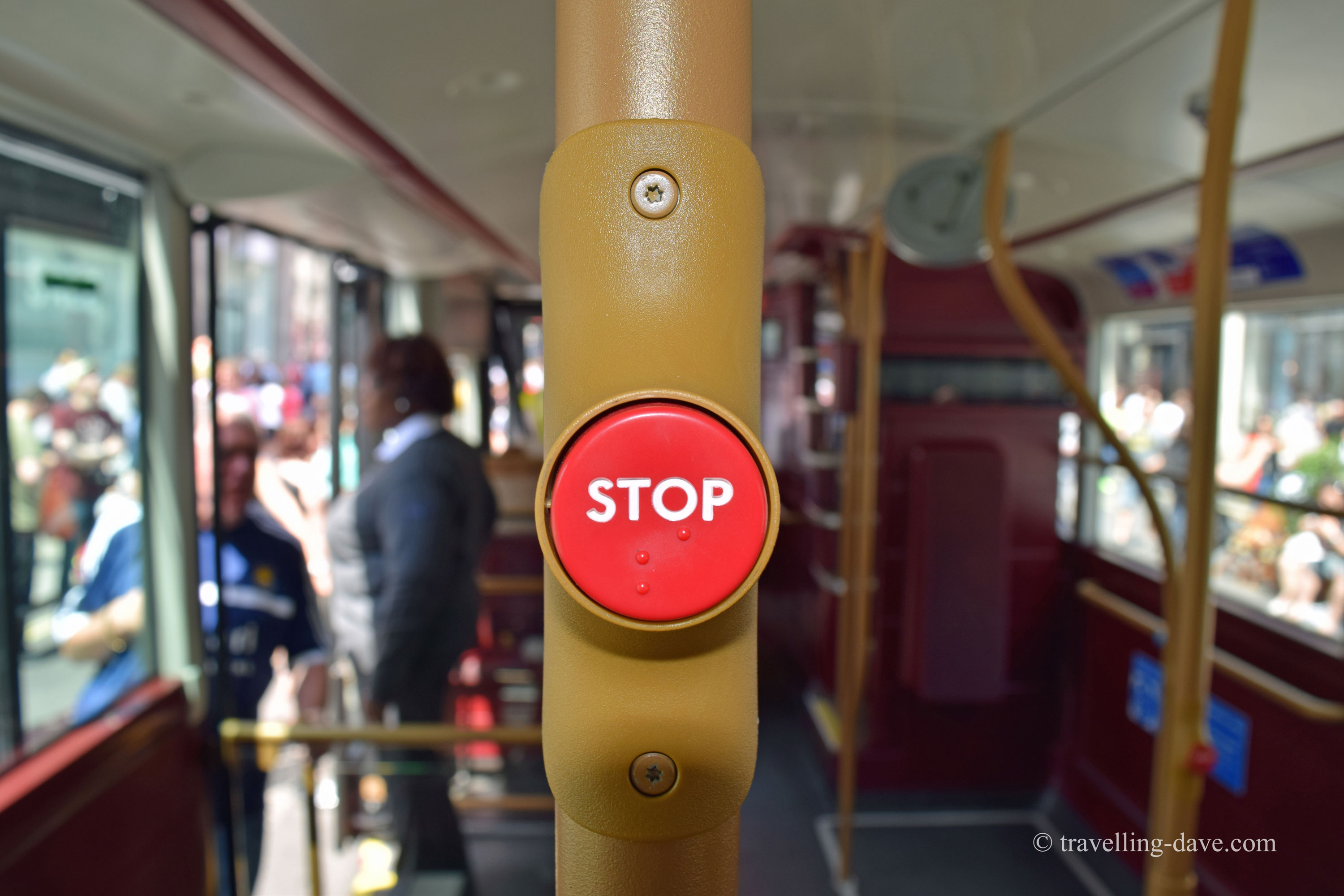Red stop button on a London bus