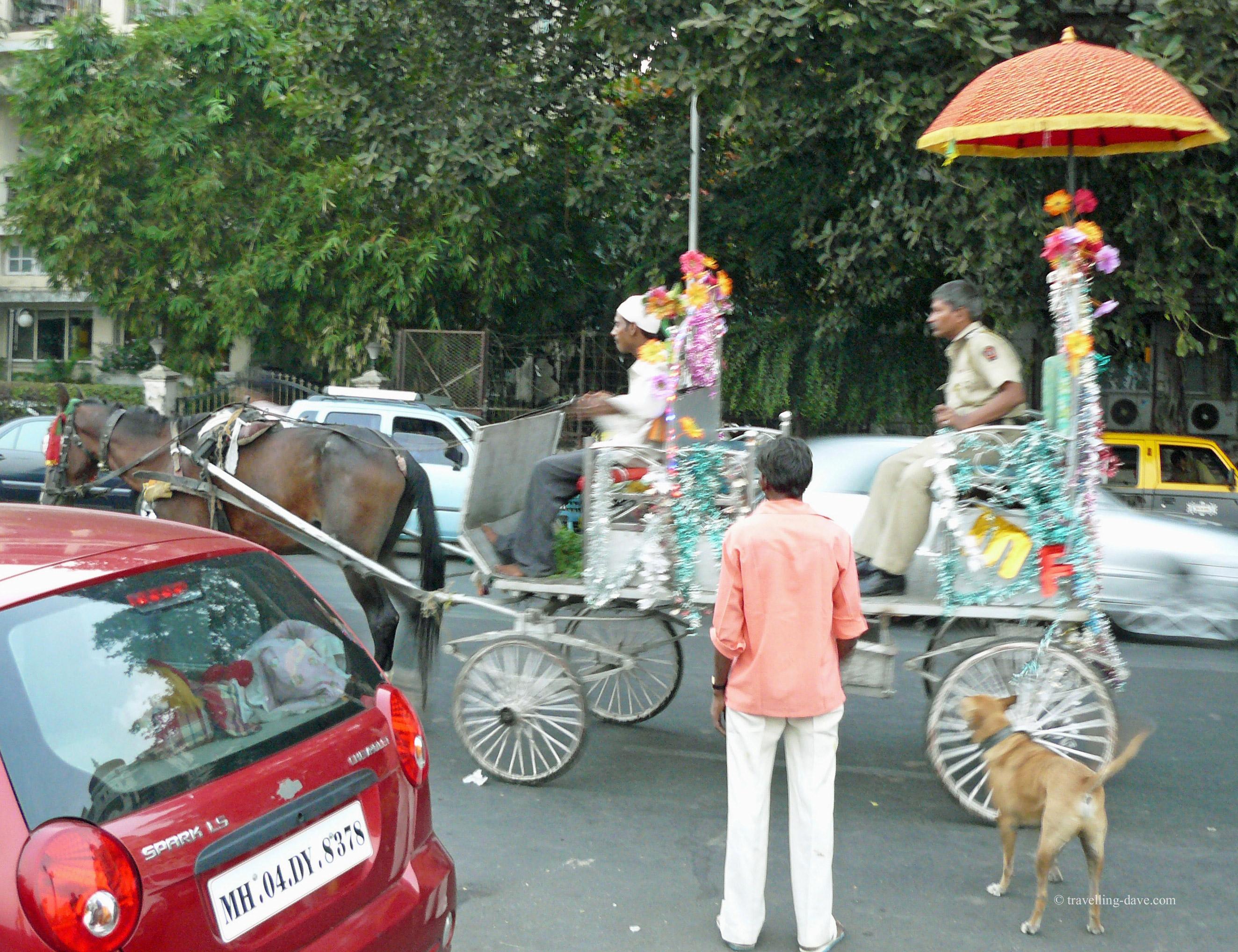 A horse-drawn carriage driven through Mumbai