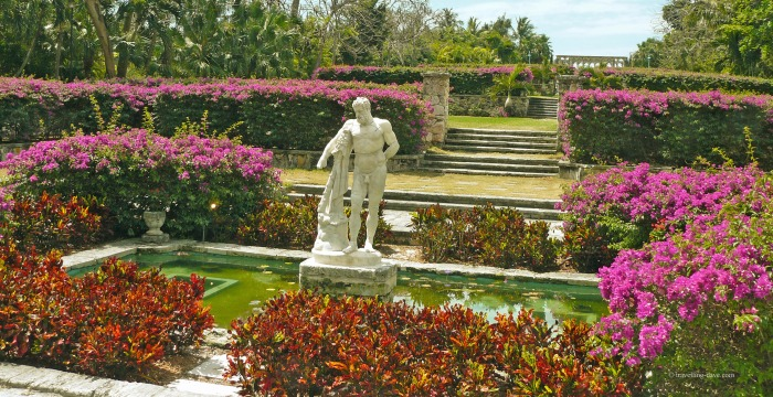 Flowers and a statue at Versailles Gardens in the Bahamas