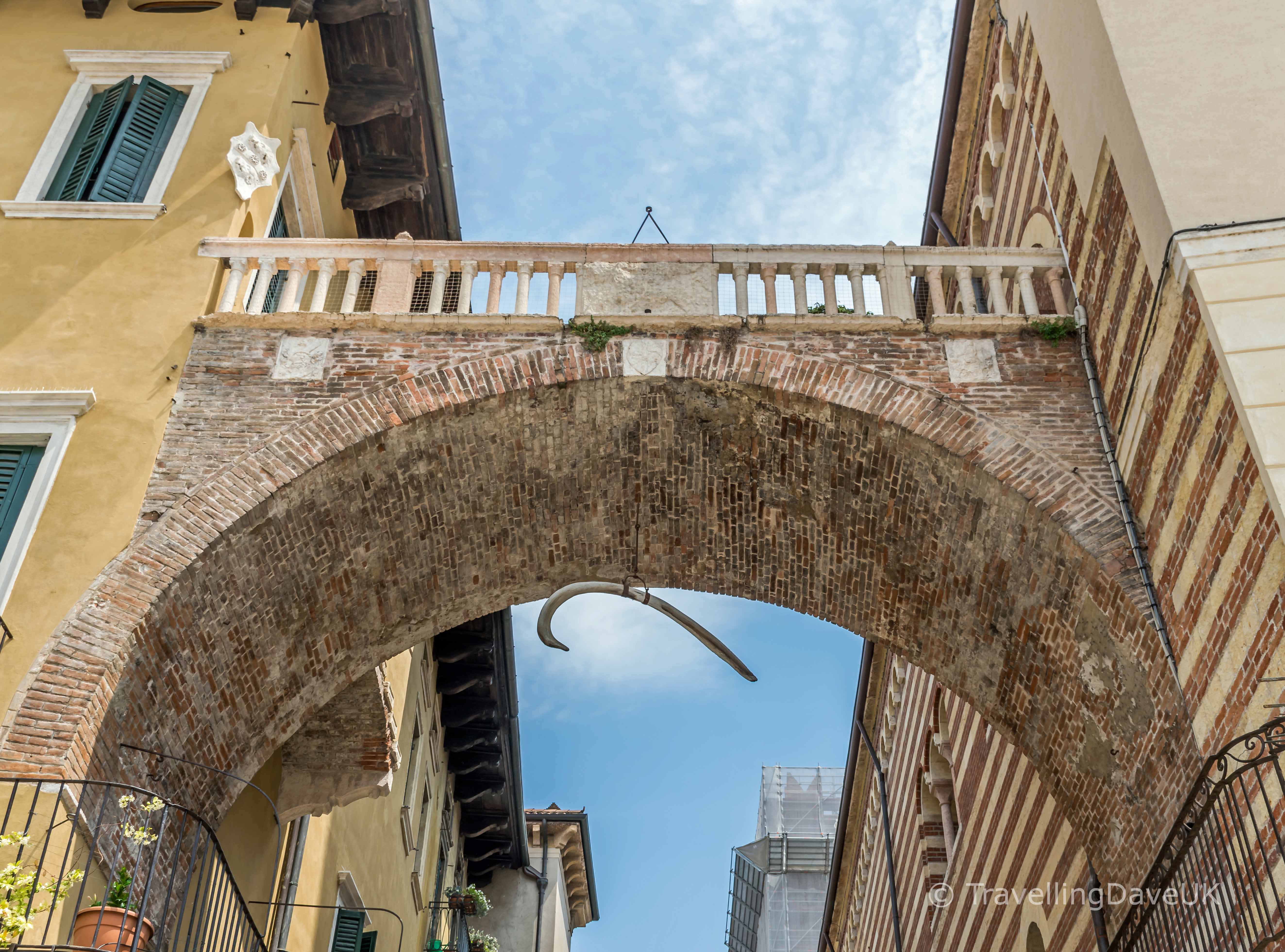 Bone hanging from Arco della Costa in Verona