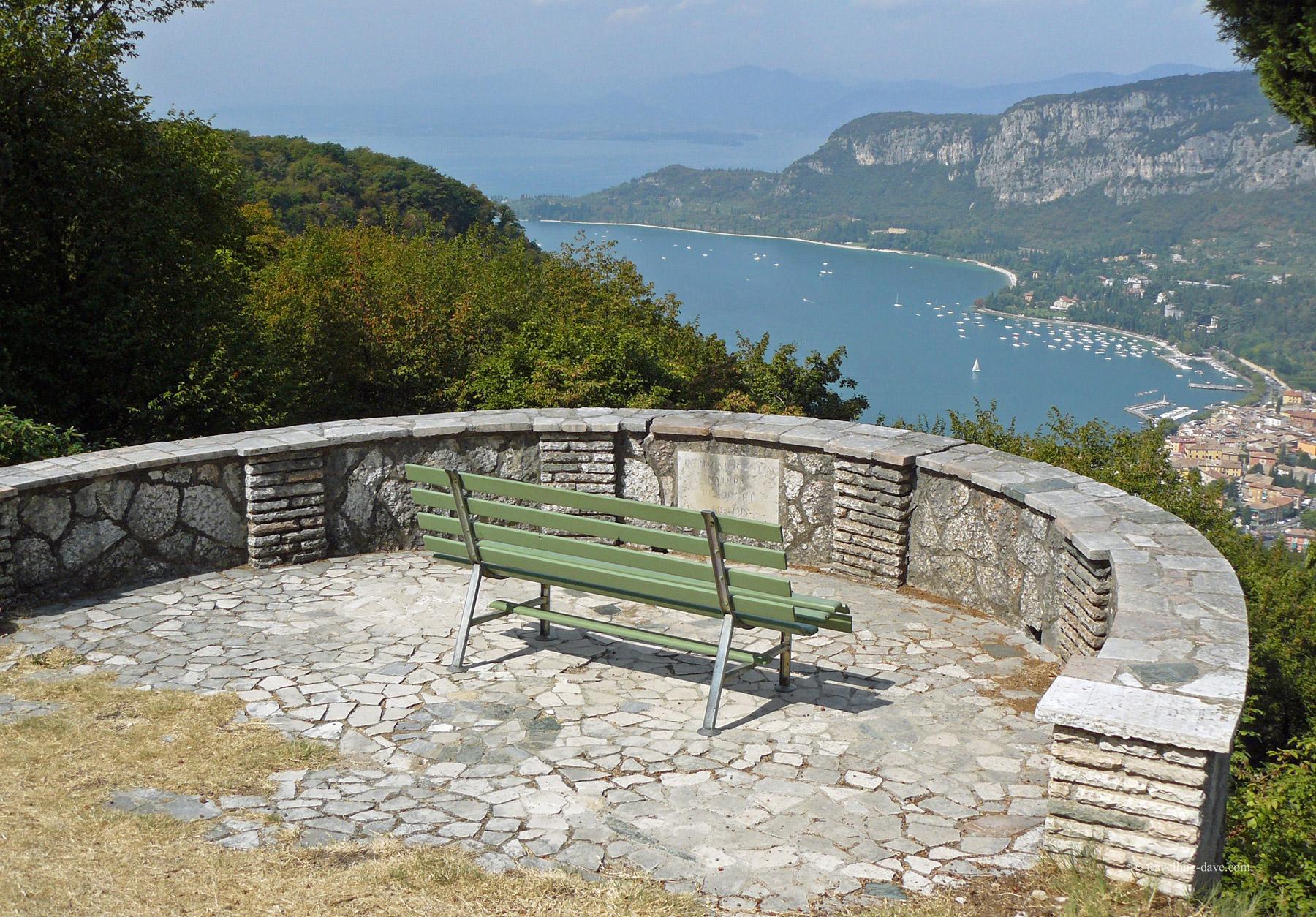 A green bench overlooking Lake Garda