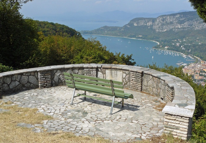 A green bench overlooking Lake Garda