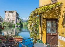 Brown door and bridge at Borghetto sul Mincio