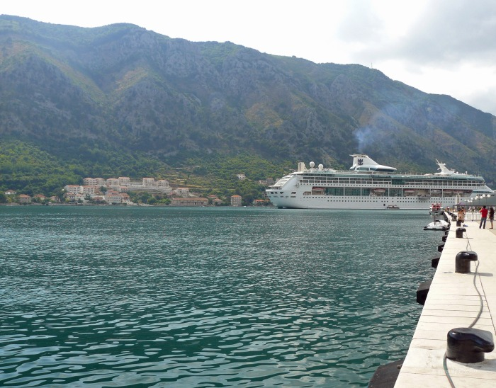 A cruise ship sailing on Kotor Bay