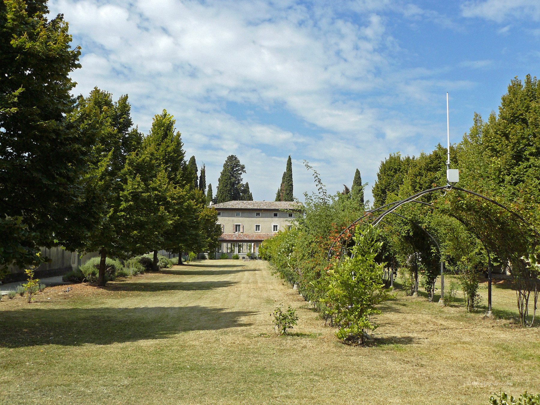 Building and trees at St.George's hermitage in Garda, Italy