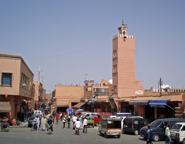 Cars and people in Marrakech Old Town