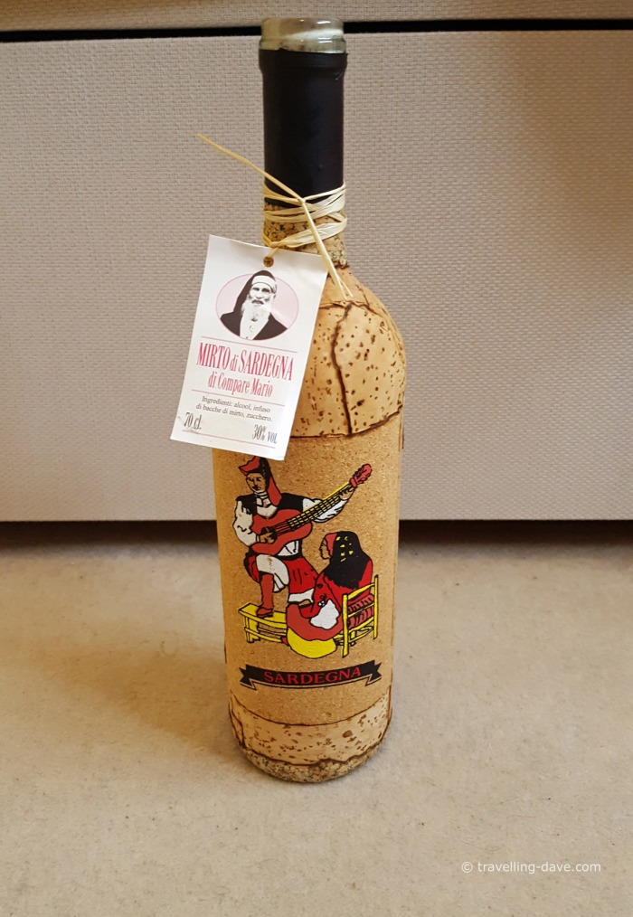 A cork covered bottle of mirto