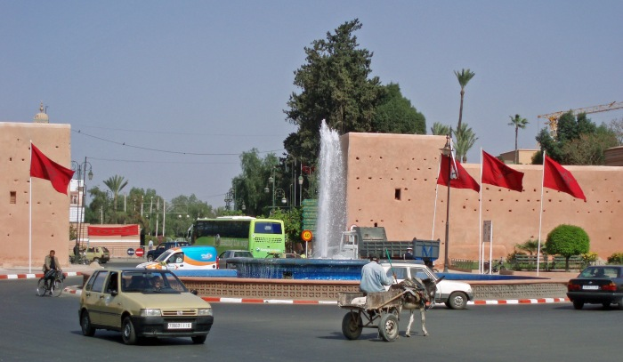 Cart and cars at the gate of Marrakech