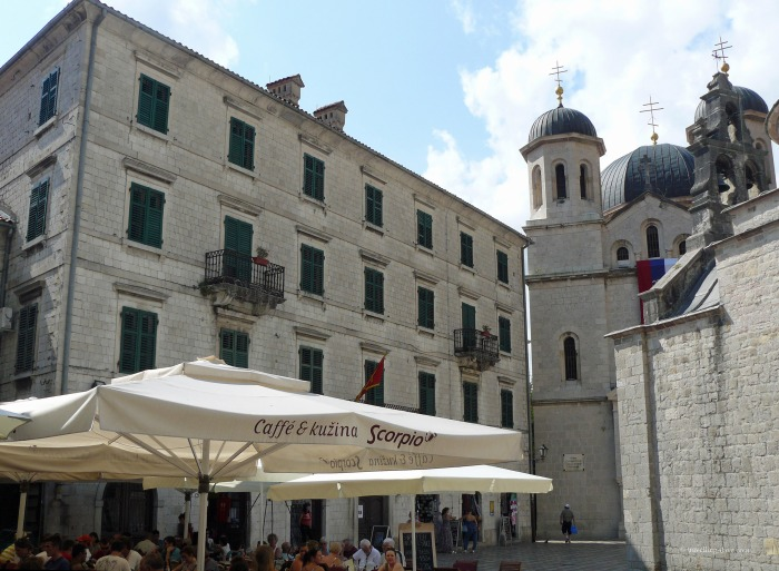 View of a cafe and a church in Kotor