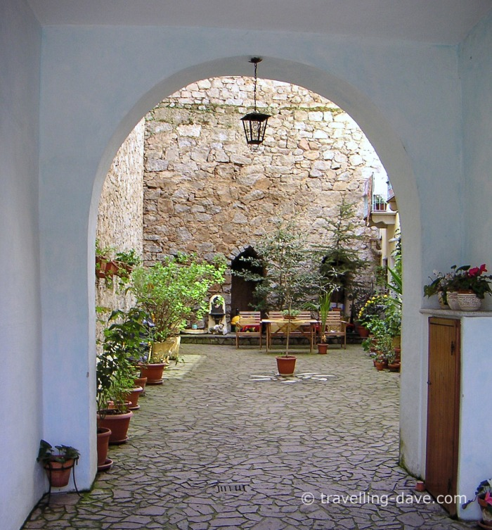 Archway courtyard entrance in Orgosolo