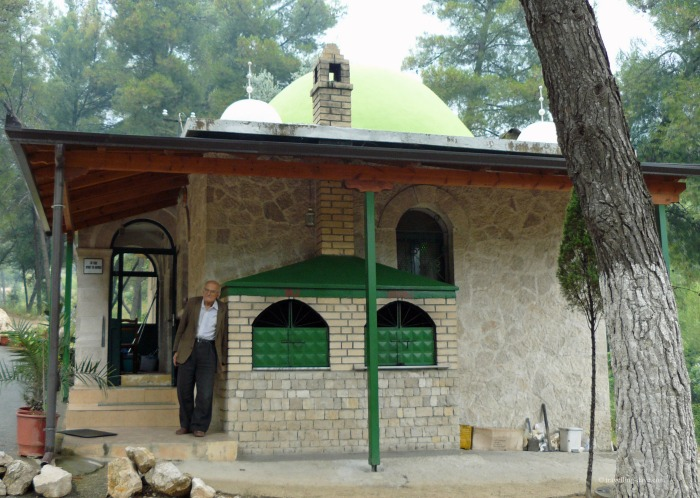 Man standing outside Sari Sartik Shrine in Albania