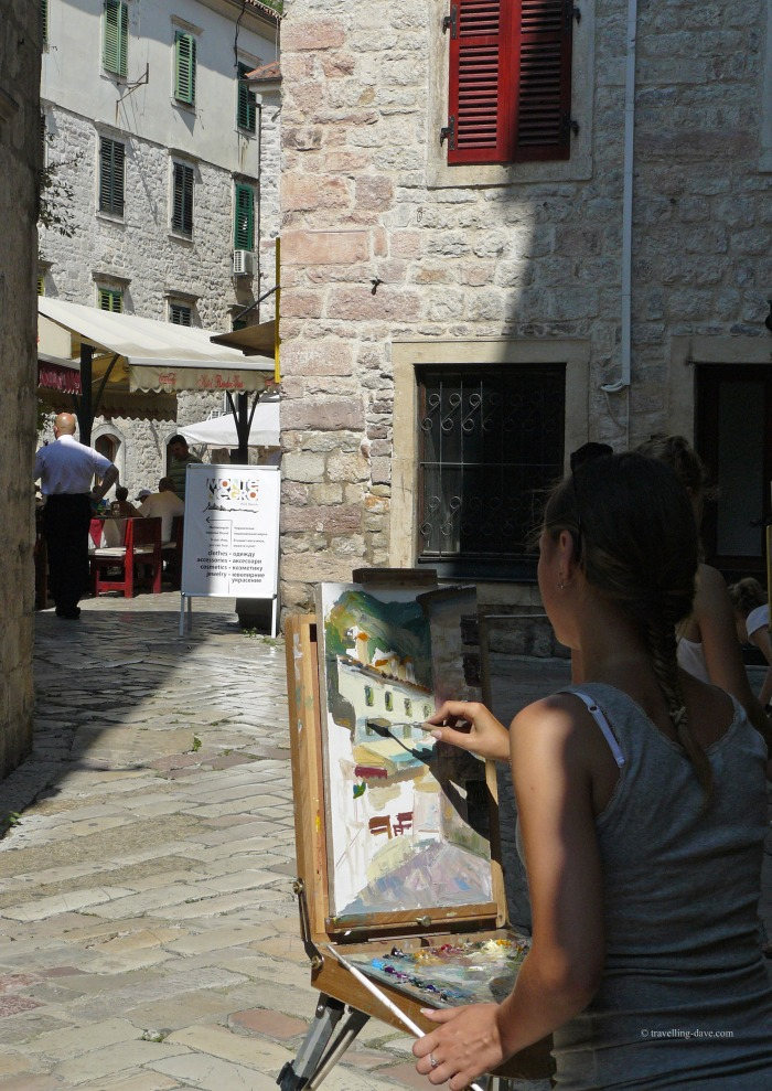 Girl painting in Kotor Old Town