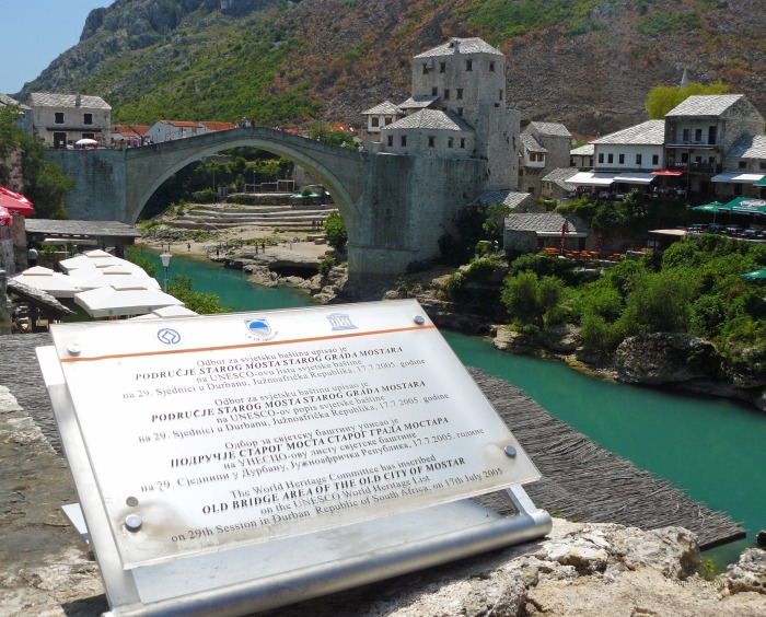 View of the UNESCO plaque and river Neretva in Mostar