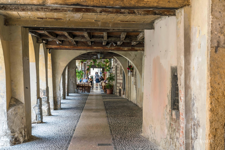 Looking down an arcade passage in Verona
