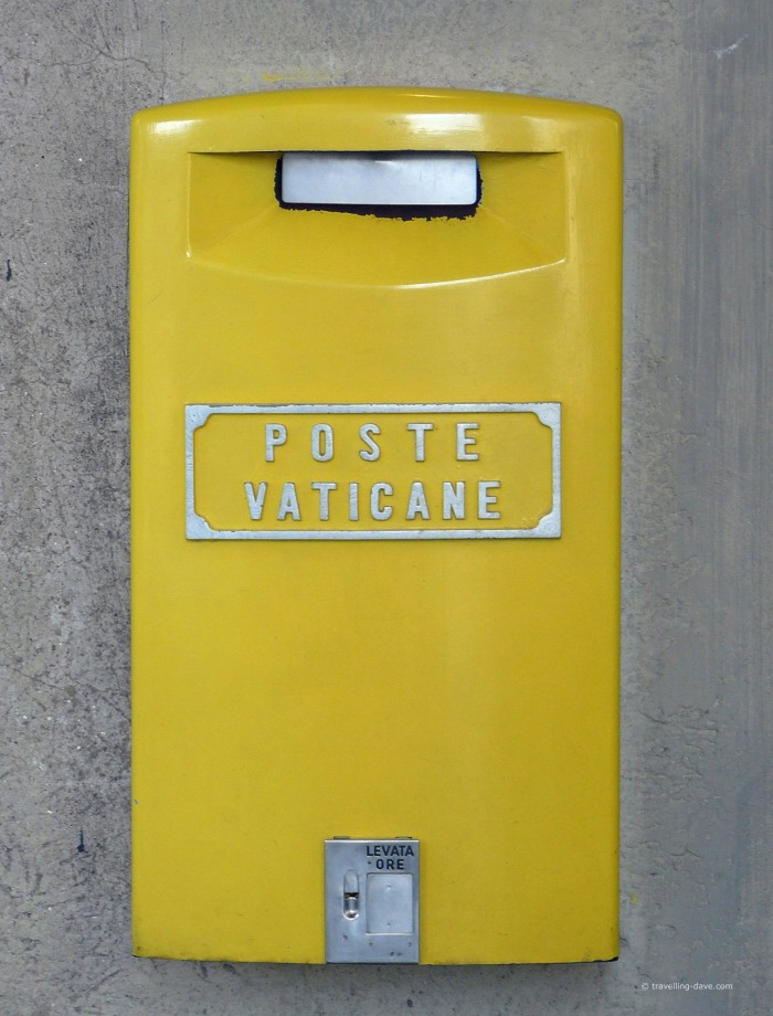 A yellow postbox in Vatican City