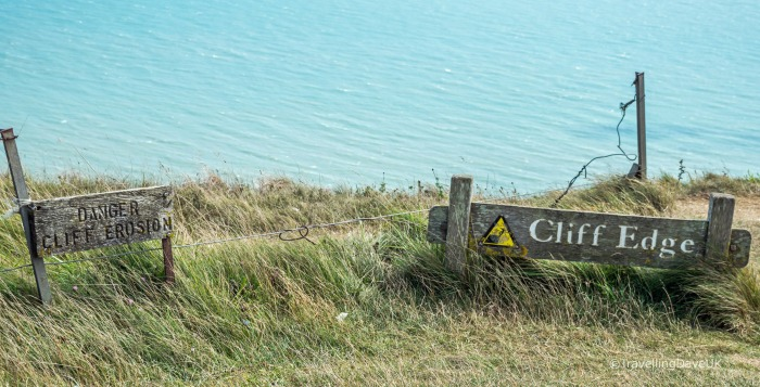 View of the warning signs at Beachy Head cliff edge
