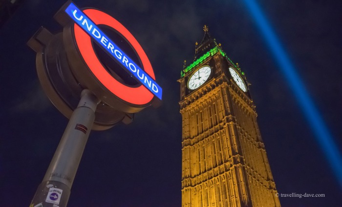 Tube sign and Elizabeth Tower at night.
