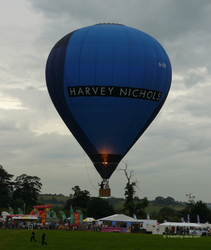 A blue hot air balloon in the evening