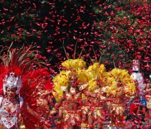 Dancers and red confetti in Notting Hill