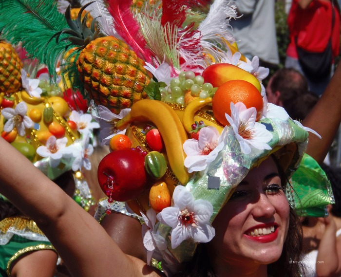 A woman wearing a fruit headgear