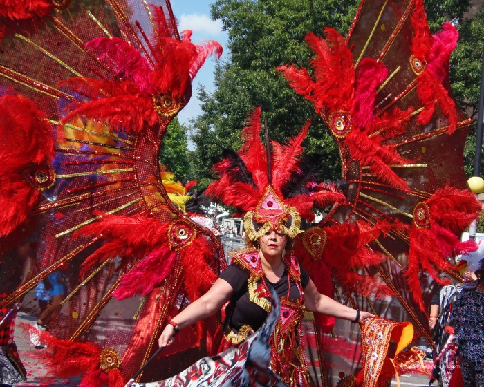 A woman wearing a red winged costume