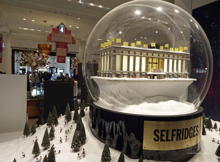 Giant snow globe in the window at Selfridges