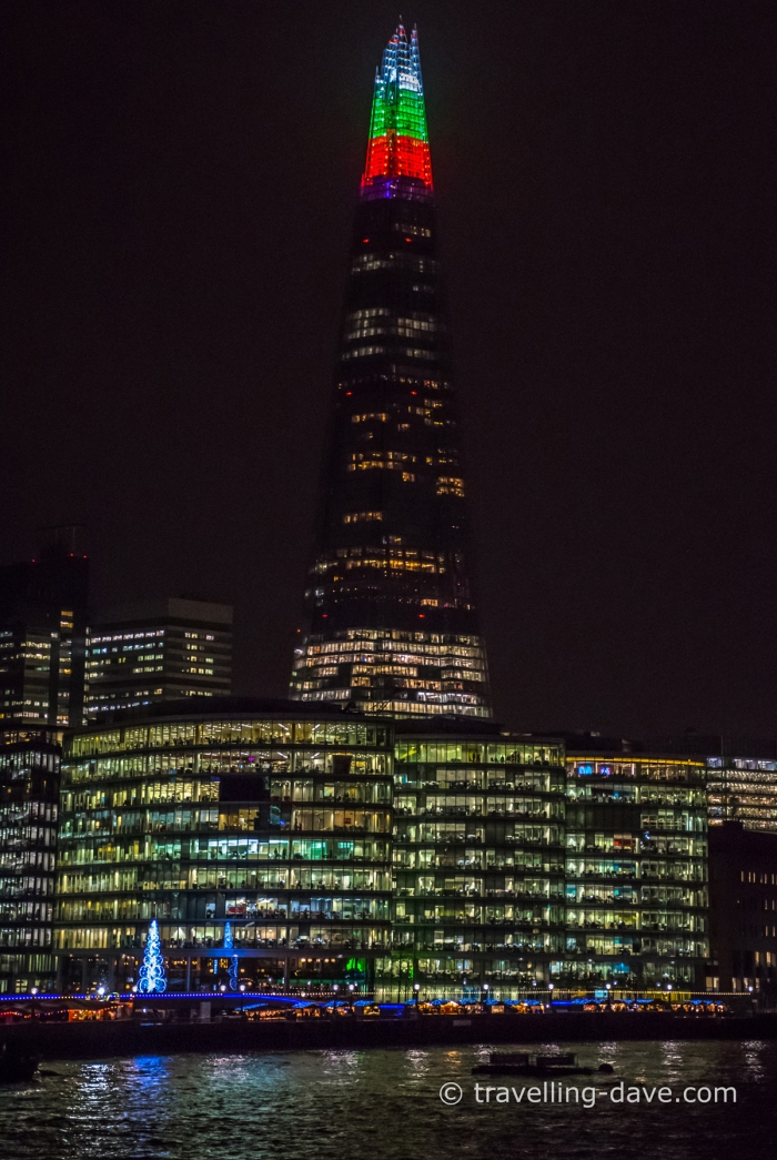 White red and green lights on the top of the Shard