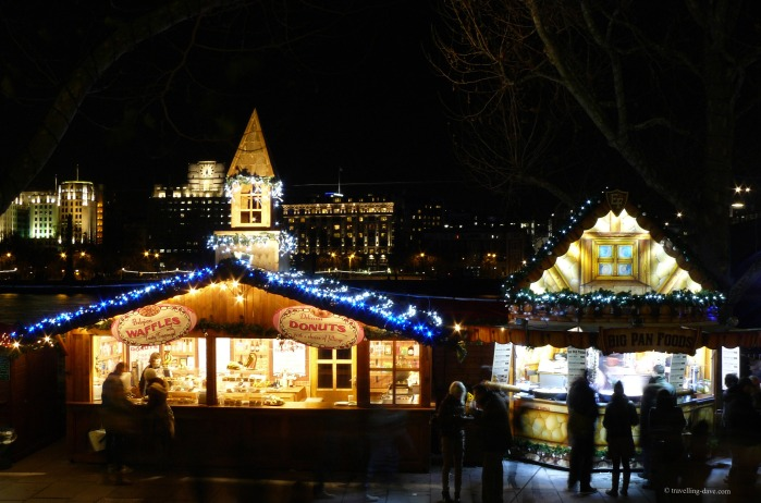 Christmas market stalls lit up at night