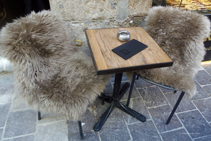 Two chairs and a table of a cafe'