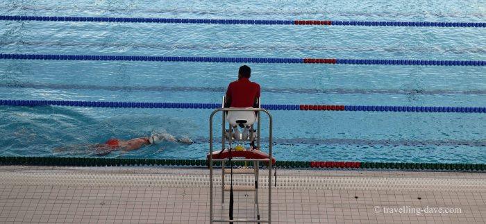 View of the pool and a lifeguard at London Aquatics Center