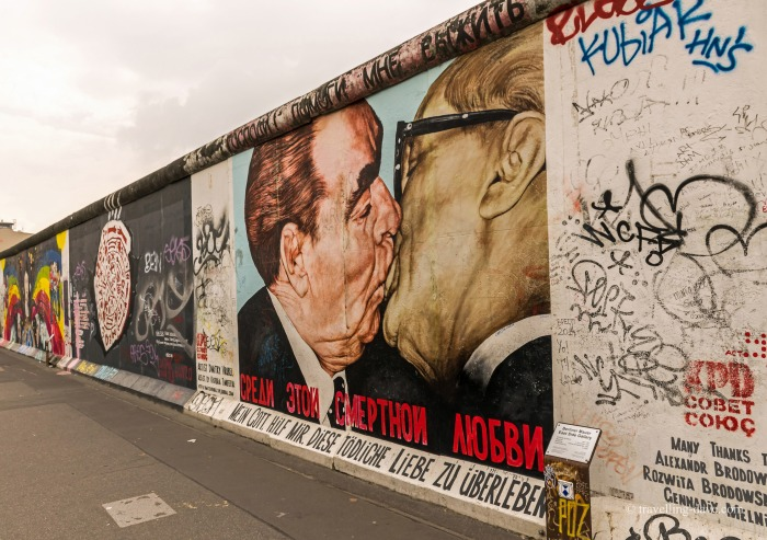 "The famous ""Socialist fraternal kiss"" painted on the Berlin Wall"
