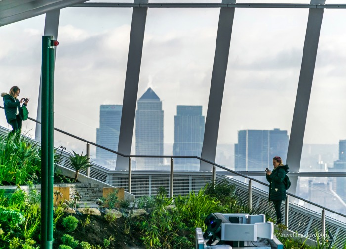 People on the steps by the window on the Sky Garden