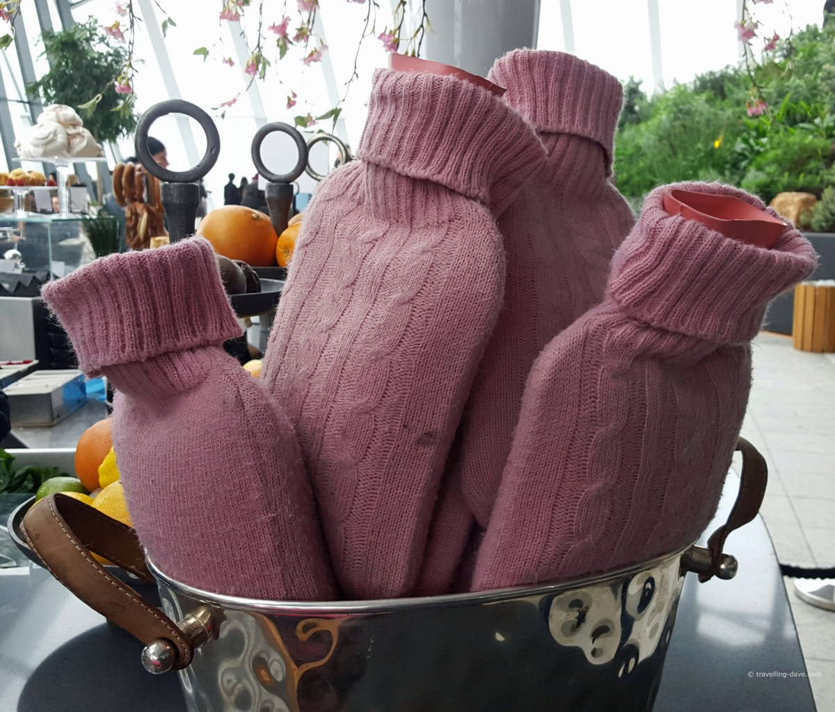 View of pink water bottles in a basket