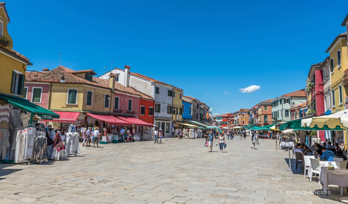 People walking on Burano's main street