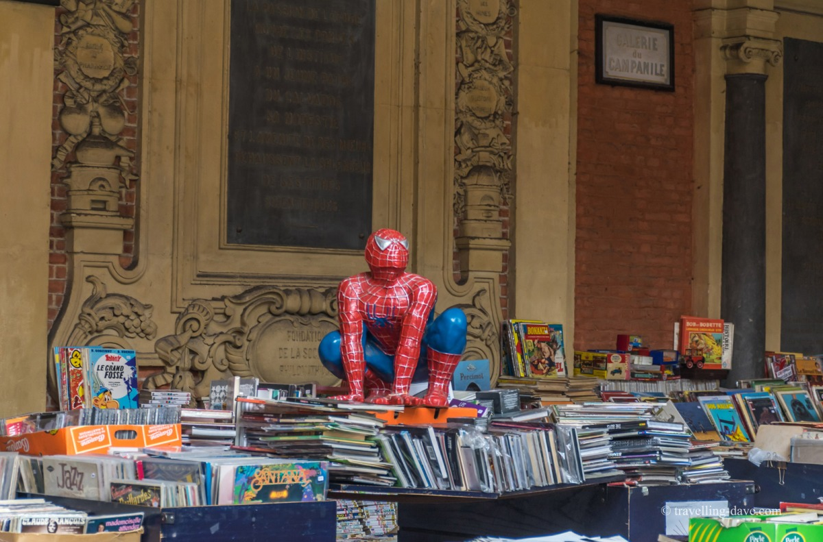 A Spider-Man figurine on top of books