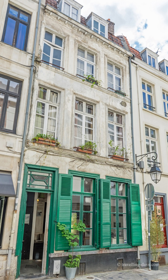 Green shutters on a shop in Vieux Lille