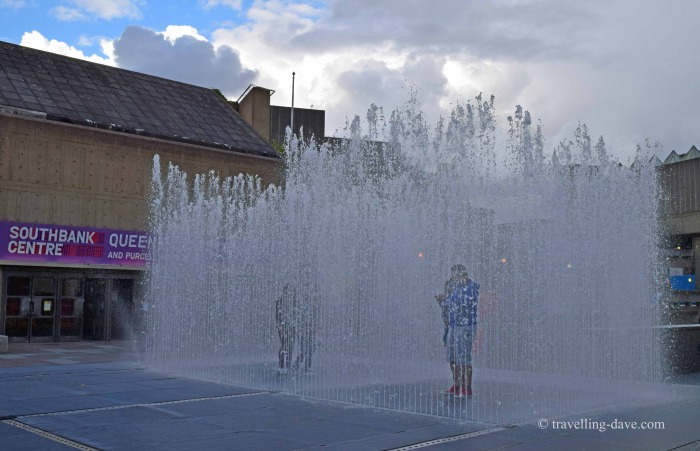 "View of people inside Jeppe Hein's ""Appearing Rooms"" Fountain"