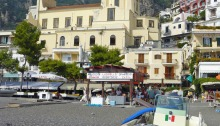 View of the beach and the cathedral in Positano