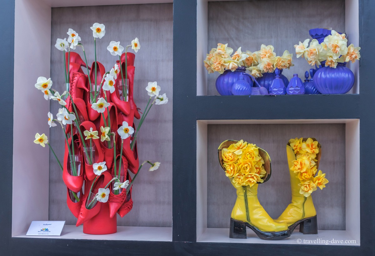 View a framed artwork of flowers and shoes