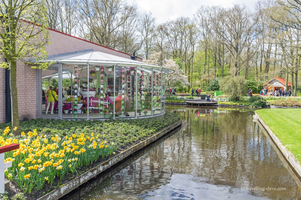People in a pavilion by the canal at Keukenhof