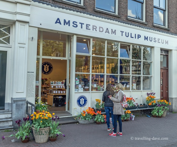 People in front of the Tulip Museum in Amsterdam