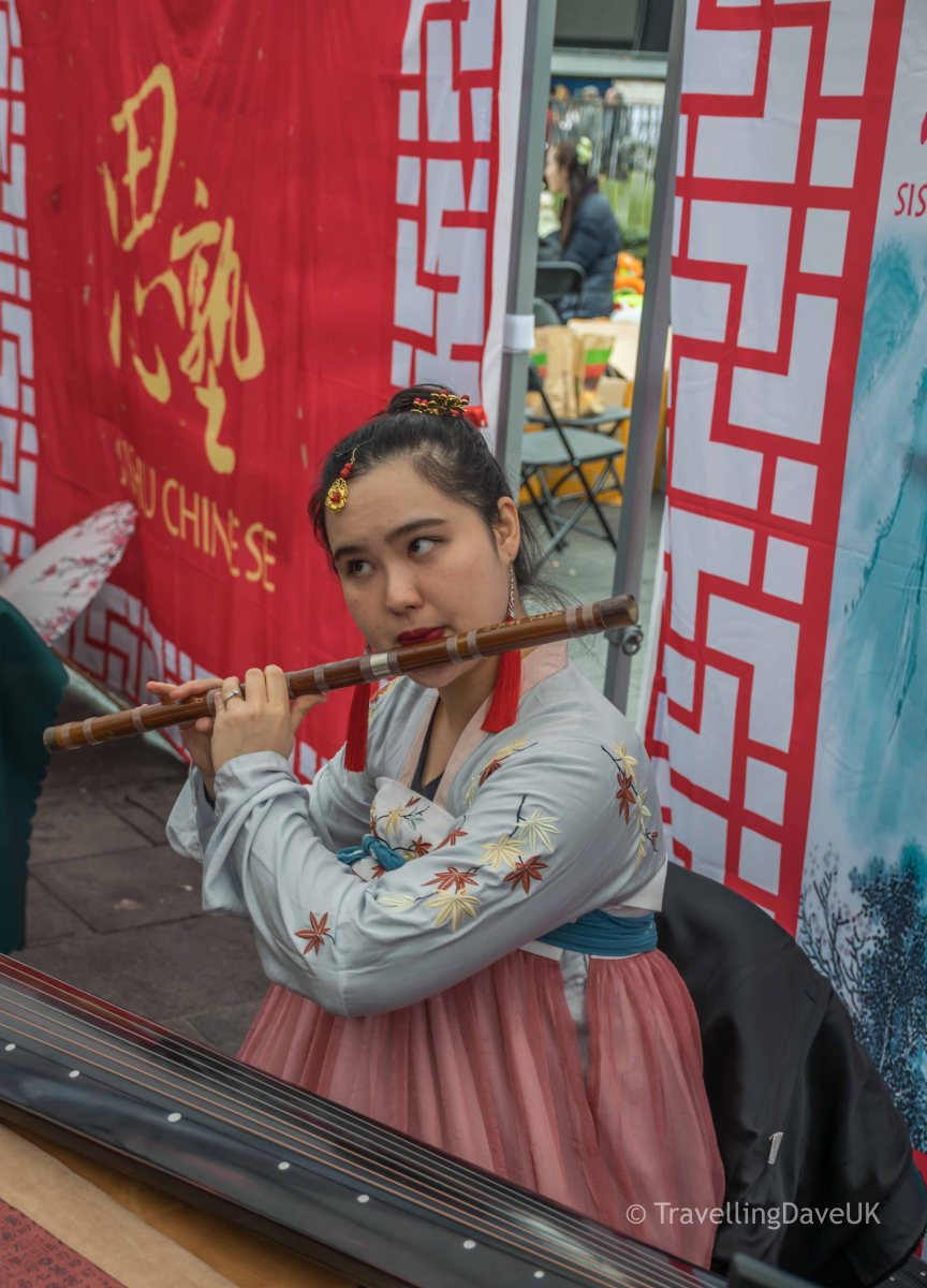 A young musician entertaining the crowds at Chinese New Year celebration